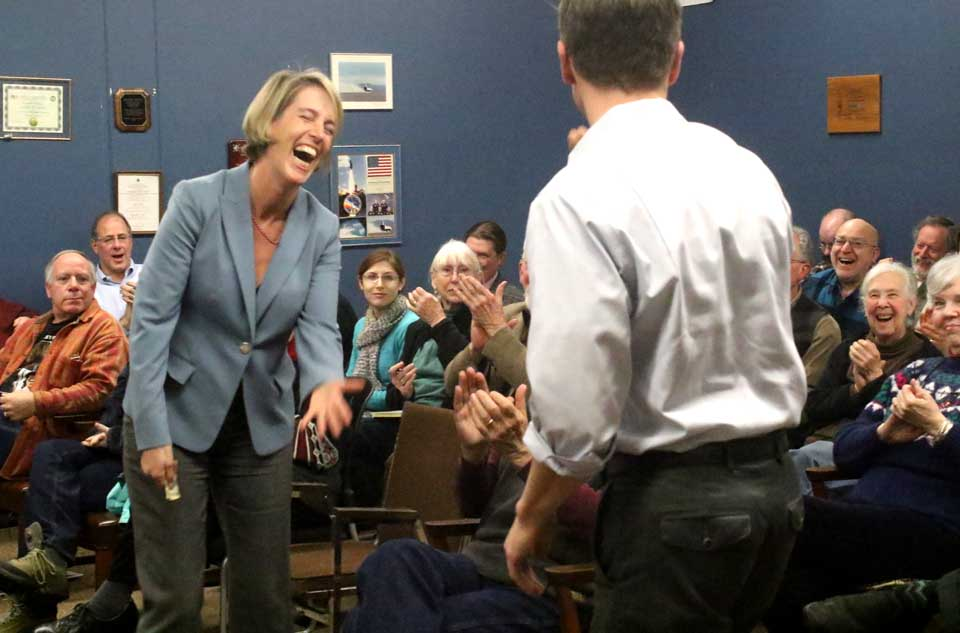 """Zephyr Teachout laughs as primary foe Will Yandik gives her a $10 bill. Earlier, Teachout described how she and Yandik have been on friendly terms, even meeting for breakfast a couple of times. """"I think you owe me $10,"""" she told him kiddingly. (Jim Kevlin/AllOTSEGO.com)"""