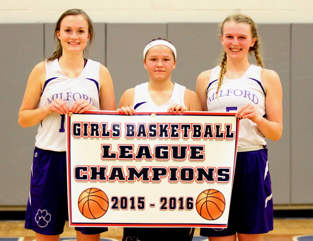Milford Central Captains Taylor Olmstead, Addy Lawson and Maddy Zenir hold the Tri-Valley League champuonship banner after the Milford Wildcats defeated the Laurens Leopards in the title game 44-36 on Saturday at Hartwick College. It was the second straight year that Milford has won the championship game. (Cheryl Clough/AllOTSEGO.com)