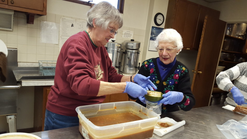 "Barbara Fritz and Eleanor Rutherford prepare hearty helpings of turkey chili to give away as part of the Elm Park Methodist Church's ""Soup To Go"" program. From 4-5 p.m. every Wednesday until March 9, you can pick up free, homemade soup to take home. (Ian Austin/AllOTSEGO.com)"