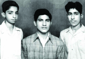 The earliest photo Malhotra has at his Center Street, Oneonta, home from his early years in India. He is flanked by two pals.
