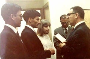 Almost two years after meeting, the couple are wed by a JP in Honolu. Nina's father, Jack Finestone, is in the background.