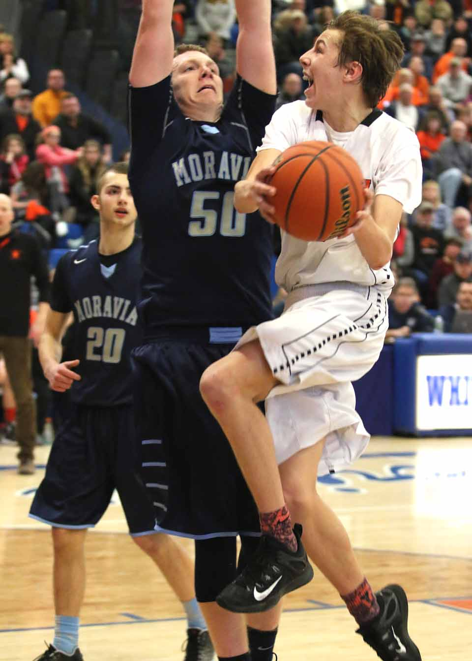 Despite 55 points by sophomore standout Tyler Bertram, the CCS Hawkeyes bowed to Moravia, 80-74, in the state quarter-finals in Whiteboro this afternoon. The two teams were neck and neck for most of the game, with Moravia gaining a lead in the fourth quarter. At this hour, the CCS girls are in the fourth quarter, 47-36.