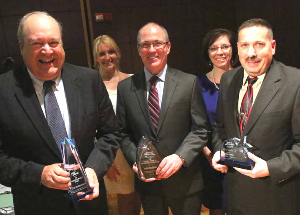Congratulations to the winners of the Otsego County Chamber Celebration of Business Awards, honored tonight at the 30th Annual Dinner and Celebration of Business at SUNY Oneonta's Hunt Union Ballroom.  From left are Dan Robinson, NYCM president, with NBT Bank Distinguished Business Award; Chamber President Barbara Ann Heegan; John Remillard, retired Fox Hospital president, with Eugene A. Bettiol Jr. Distinguished Citizen Award; Chamber Vice President Kelly Zack-Decker, and Frank Russo, Onoenta Family Y executive director, with Quality of Life Award.  (Ian Austin/ AllOTSEGO.com)
