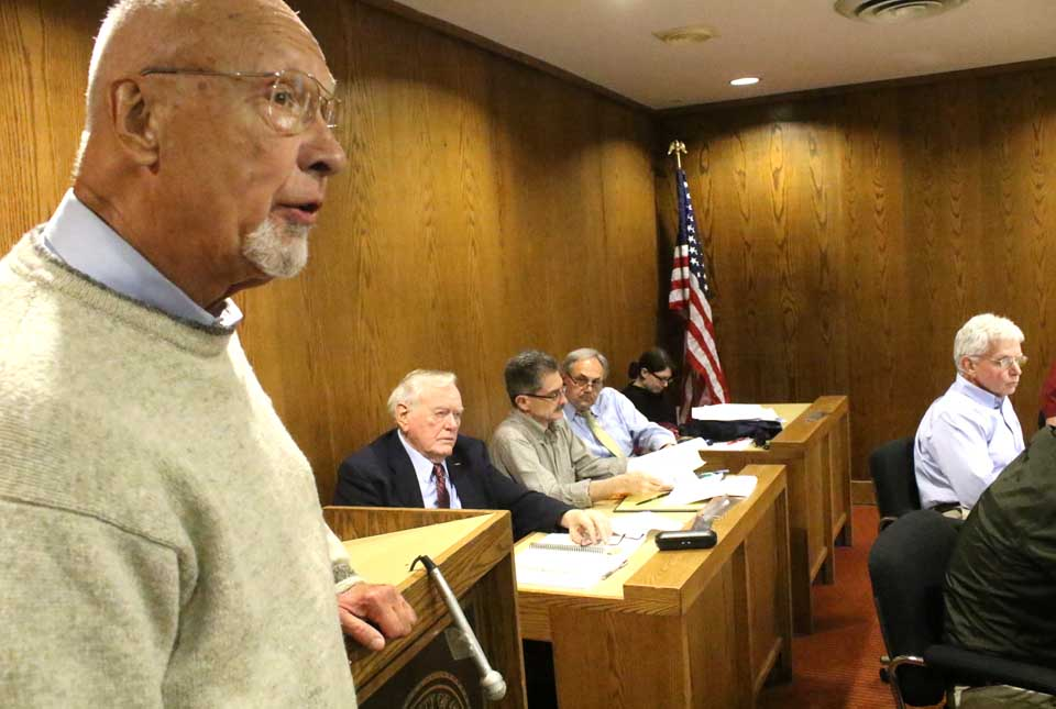 Paul Scheele, retired SUNY Oneonta poly-sci professor and a member of the original Charter Commission, expressed concerns moving city manager qualifications out of the City Charter will lower the bar. Behind him are ad hoc Charter Revision Committee members David Brenner, David Martindale and John Nader, who chaired that effort. At right is Council member John Rafter, chair of Common Council's Legislative Committee, which reviewed the new charter revisions this afternoon. (Jim Kevlin/AllOTSEGO.com)