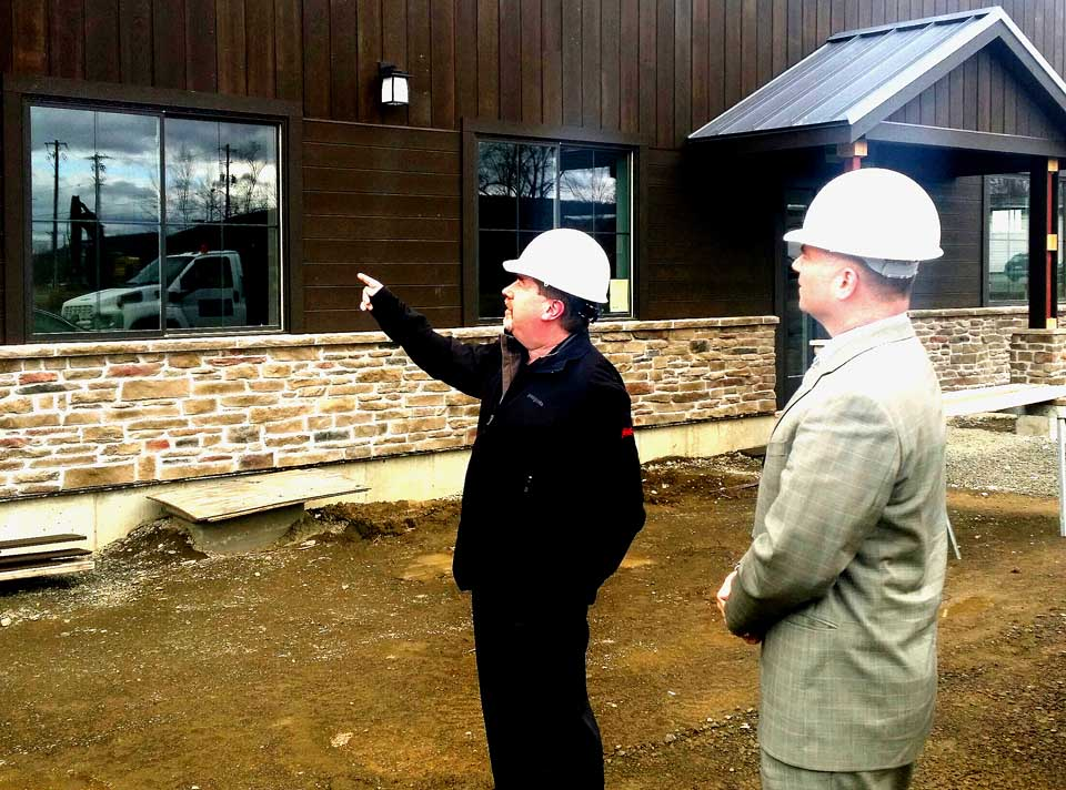 Northern Eagle Beverage President George Allen, left, shows U.S. Rep. Chris Gibson, R-19, the nearly complete Hager Hops brewery on Browne Street, Town of Oneonta, during a tour of the county today. Gibson also met with church leaders in Gilbertsville.
