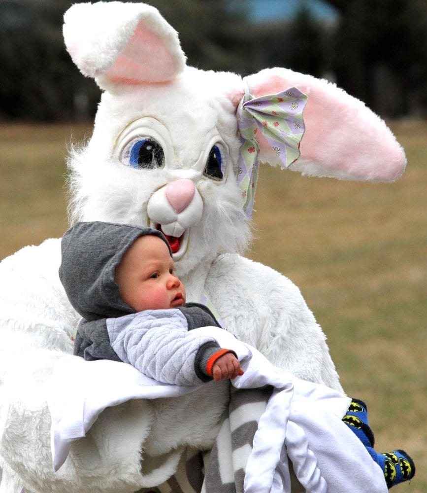 9-month old Nicolai Jacksto meets the Easter Bunny for the first time this afternoon at the Goodyear Lake Easter Egg Hunt.  (Cheryl Clough/AllOTSEGO,com)
