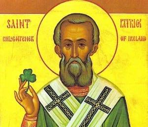 St. Patrick holding a shamrock.
