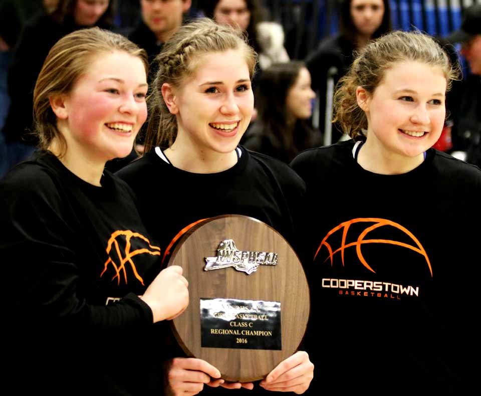 """Smiling seniors Jen Flynn, Liz Millea and Mallory Arthur hold the plaque declaring them Regional Champs"""" after winning the state quarter-finals this afternoon in Whitesboro. (Brian Horey/AllOTSEGO.com)"""
