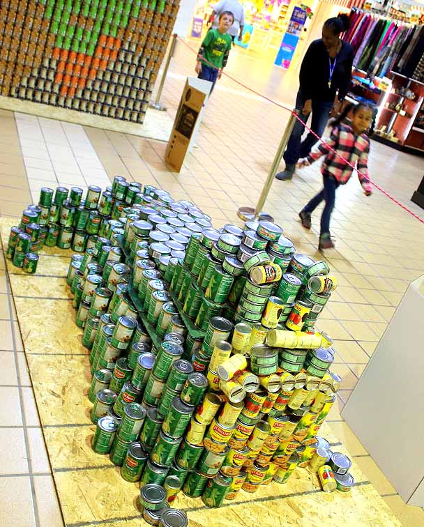 A common Star Wars theme is present in this year's Canstruction, now on display in the Southside Mall. Here, Oneonta's Autherine Gordon, Gavin Williams and Giana Watson look at 'Jabba the Can-Hutt', created by the Hannaford building team, front, and a picture of Yoda by 5 Star Subaru, rear. Other submissions include houses, logos and more. The national event has donated over 40 million pounds of food to charity since it began in 1992 and is hosted in 150 around the globe.(Ian Austin/AllOTSEGO.com)