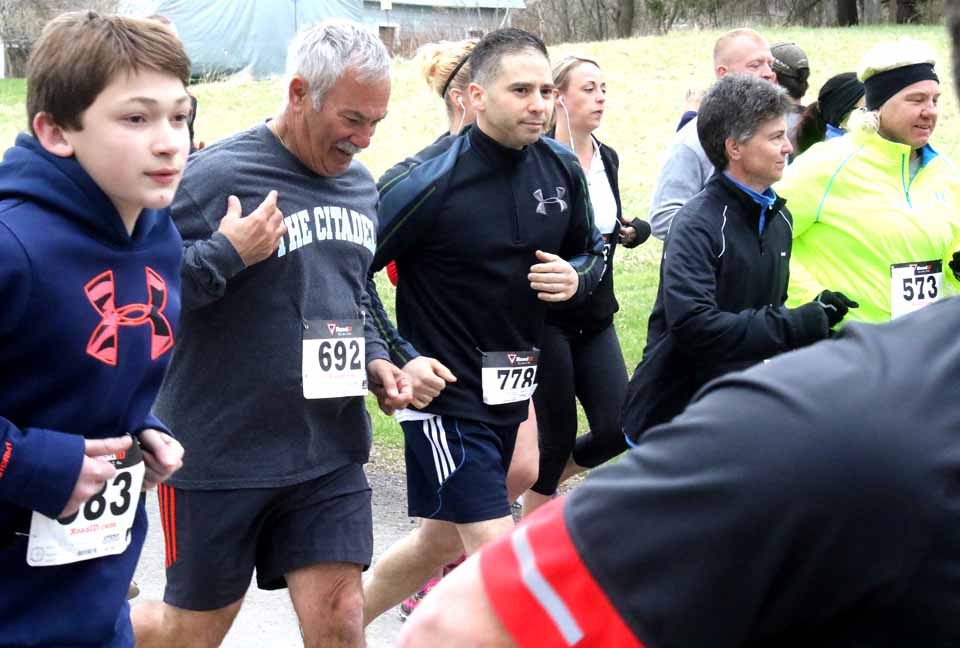 Oneonta Police Chief Dennis Nayor (778), accompanied by retired OPD officer Gordy Saggese (692), were among the 200 runners in this morning's fourth annual Cider Run at Fly Creek. Even before today's event, which benefited Athelas Therapeutic Riding in Otego, had raised $30,000 for local efforts. (Jim Kevlin/AllOTSEGO.com)