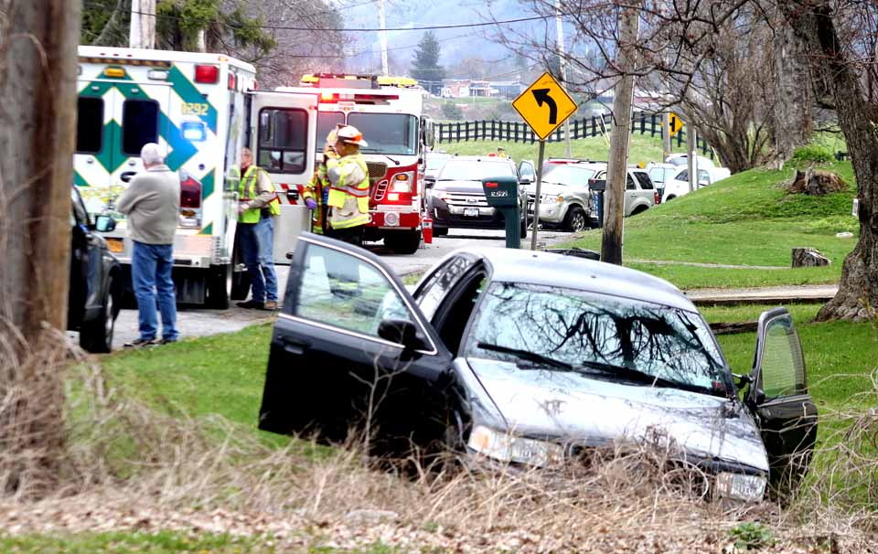 Traffic is tied up on Route 28 south of Cooperstown at this hour, between Smith Ford and the Toddsville turnoff, after two southbound cars appear to have collided and come to rest, facing south, on the east side of the roadway. A black Ford sedan was on the north property line of Judith Brown CPA's offices, 5082 Route 28, while a tan Ford SUV was a few properties north, in front of that red cape. Cooperstown EMS and a fire truck were at the scene, with Fire Chief Jim Tallman directing emergency activites. Sheriff's deputies were investigating. It didn't appear that either drivers were injured. Traffic was being guided through, north bound and south bound alternately. Kirn's wreckers had just arrived about 10 minutes, awaiting the go-ahead to remove the involved vehicles. While neither vehicle seemed too seriously damaage, debris was scattered along the pavement. (Jim Kevlin/AllOTSEGO.com)