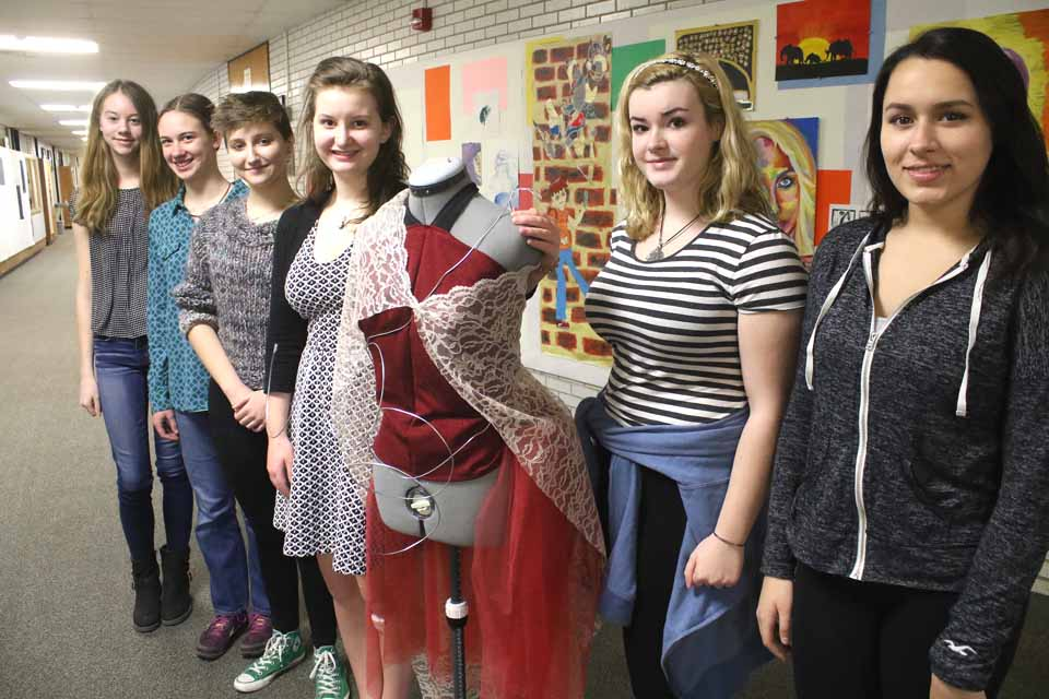 Couturiers preparing for CCS' Cooperstown Fashion Show at 7 p.m. Thursday, April 21, are, from right, 11th graders Megan Lohan, Rachel Carpenter and director Lindsay Brown (standing next to one of her creations); 10th grader Ilsa Dohner, Lindsay's assistant; and eighth graders Mikeeli Hanson and Kara Gildea.    The show will be in the school's Sterling Auditorium, followed by a reception.   Admission $5. (Jim Kevlin/AllOTSEGO.com)