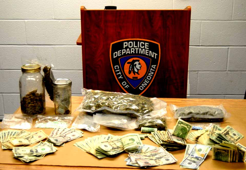 Suspected Xanax, marijuana and cash were seized by police in an early-morning raid on Elm Street.