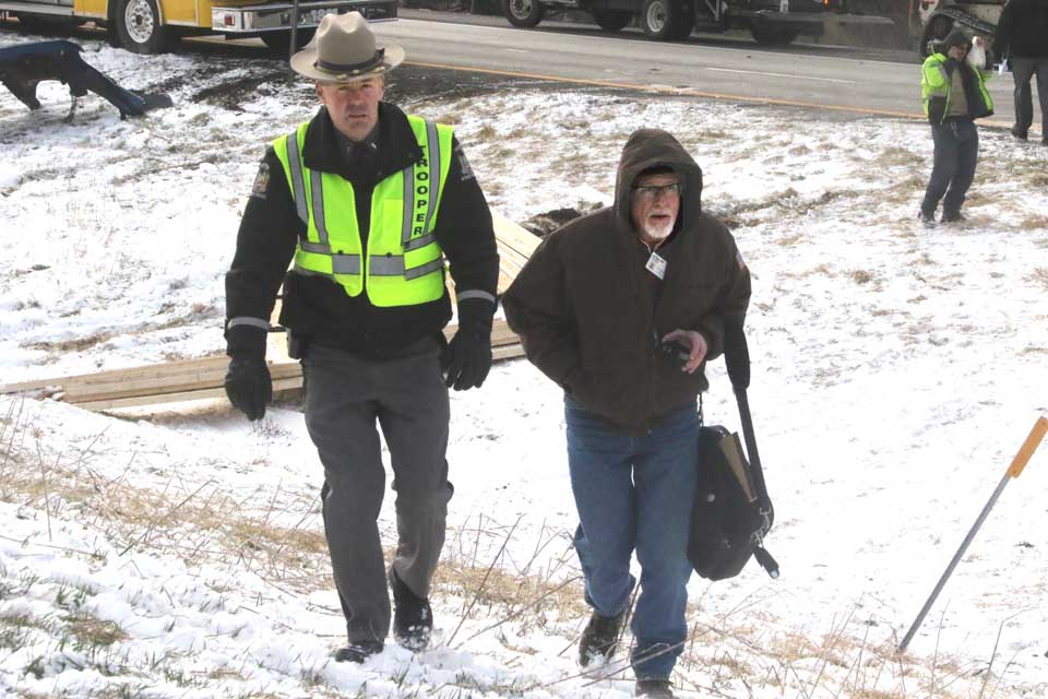 State Police Lt. Dan Larkin shows a media member around the scene.