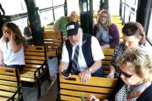 At least Mayor Katz (in green shirt) was taking in Cooperstown's nationally known features. Everyone else on the inaugural ride had eyes glued to tiny screens to chart the trolley's progress.