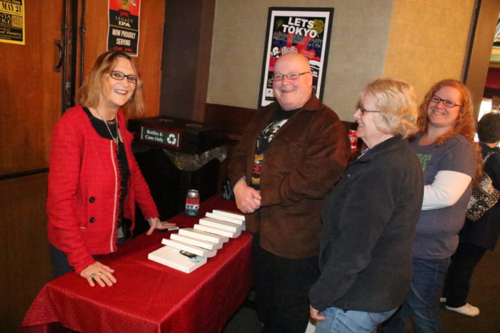 "Julia Baird, John Lennon's younger sister, chats with Brad Wilfeard, wife Kathie and daughter Andrea, Cooperstown, during the meet and greet portion of tonight's concert by The Mersey Beatles at the Oneonta Theatre. She was signing copies of her book """"Imagine This: Growing Up With My Brother John Lennon"". (Ian Austin/AllOTSEGO.com)"
