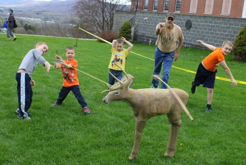 "Ron Maxwell, Sidney, in tan, teaches Oneonta boys Hunter Booth, Matthew Stedman, Ethan Stedman, and Corbin Booth the finer points of spear throwing outside the Quad at Hartwick College this afternoon. The workshop was part of the first Yager Days, a family event planned and organized by Museum Studies students to teach children about history and archaeology. Participants could learn to throw an atlatl, make art prints in the style of Warhol, dig for arrowheads, listen to native American folklore and more. ""We had about 80 people come through."" said Hartwick senior Alex Wichowski, who was manning the Junior Archaeology table. ""Wehope that this event will continue on in coming years."" (Ian Austin/AllOTSEGO.com)"