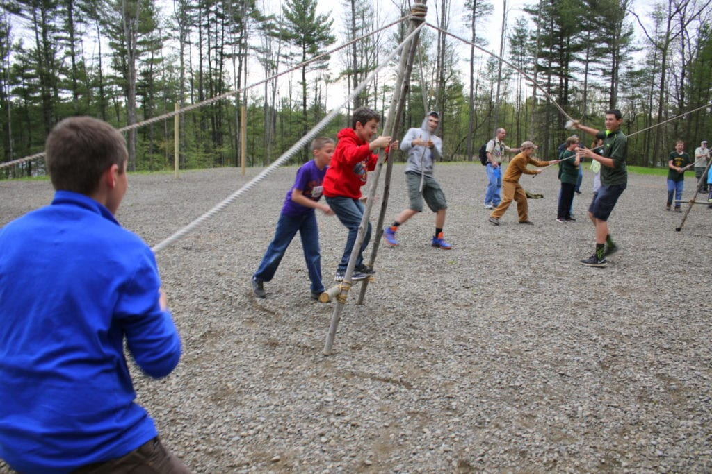 Boy Scouts Johnathan Child, Lincon Waffle, Robert Child and Benjamin Child, all members of Troop 3 in Morris, practice teamwork with a walking A-frame exercise where communication and alternating forces help to 'walk' the frame carrying Thomas Pondolfino, Oneonta. The boys were on site at the Henderson Scout Reservation as part of the 'Pleased To Meet-Cha Camporee', which was celebrating the first time all troops of the newly formed Leatherstocking Council have come together since it formed from the Revolutionary Trails Council and Otchodela Council formed last year. (Ian Austin/AllOTSEGO.com)