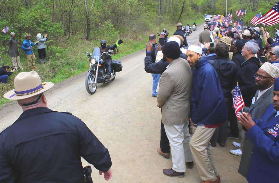 "Five ""American Patriots Against Jihad"" motorcycles and five vehicles pass by Islamberg this afternoon, a much-feared confrontation that was over in a few seconds. (Ian Austin/AllOTSEGO.com)"