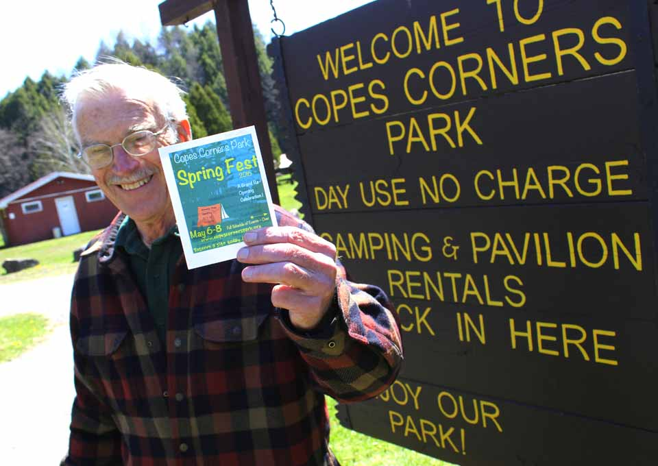 Fred Johnson, chair of the Copes Corners Park Committee, issues the welcome: Come to the Spring Fest that begins tonight. (Ian Austin/AllOTSEGO.com)