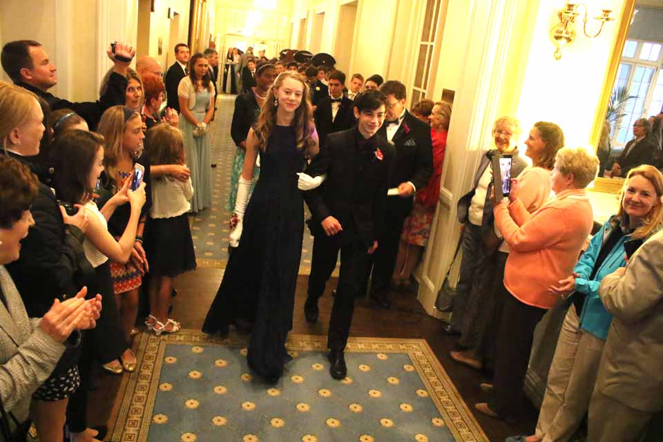"Kara Gildea is escorted by Joseph Senchyshyn into the 2016 Cooperstown Cotillion this evening at The Otesaga. More than a half-century tradition, the cotillion introduces Cooperstown eighth graders to ballroom dancing and good manners, which – emcee Roger Lansing said hopefully – ""we hope they're using at thome."" (Jim Kevlin/AllOTSEGO.com)"