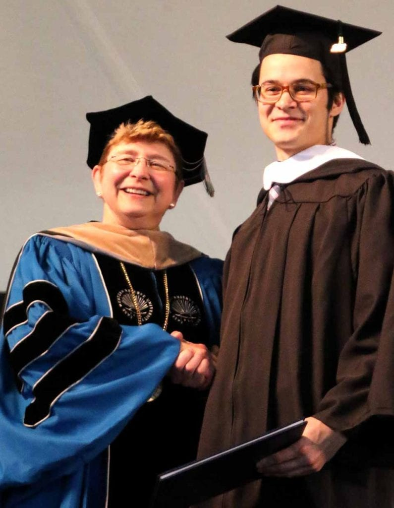 A beaming college President Margaret L. Drugovich presents a degree to Jackson Maloney at Hartwick's 85th commencement Saturday, May 21. He is the son of Jim Maloney and Elizabeth Bloom. (Ian Austin/AllOTSEGO.com)