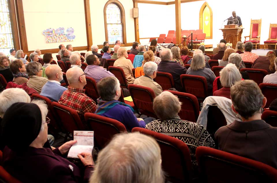 More than 100 people almost filled Oneonta's Unitarian Universalist Church, where Lee Fisher, president, NAACP's Oneonta chamber, offered encouragement and support to representatives of Islamberg, Delawares County. (Jim Kevlin/AllOTSEGO.com) Ford Av
