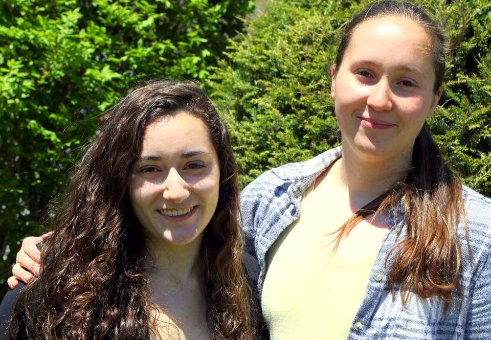 Nisha Labroo, left, is the valedictorian of the Oneonta High School Class of 2016, and Emily Louckes is salutatorian.  Both will address their classmates at commencent on Saturday, June 25.  For details on Nisha and Emily's plans, see this week's edition of Hometown Oneonta, on newsstands Wednesday afternoon.  (Ian Austin/AllOTSEGO.com)