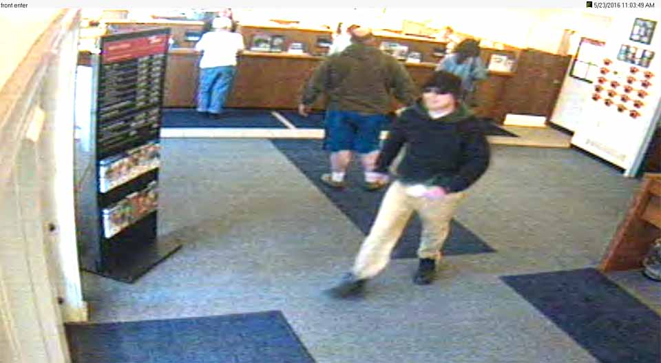 The suspect strides across the lobby of NBT's Edmeston branch this morning in this video released by the Otsego County Sheriff's Department.