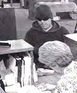 Here's a closeup of the suspect at a teller station.