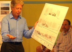 Architect Kurt Ofer reviews drawing showing the building will have a low profile and be sheltered from Route 80 by the existing line of trees.