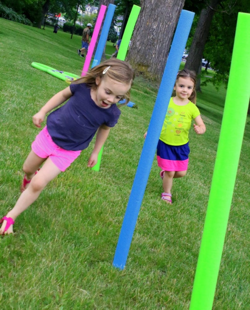Oneonta sisters Nora and Evie Sander, run through an obstacle course outside the Huntington Memorial Library this afternoon as part of Fabulous Fridays. The event was moved from downtown to the lawn of the library as a change of pace, and featured children's crafts, hula hooping, live singing and dancing and a magic show. (Ian Austin/AllOTSEGO.com)