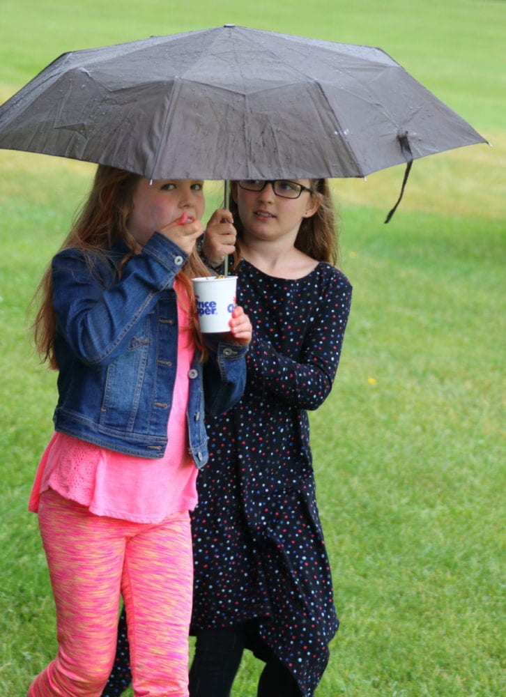 It was a wet and windy day for the 9th annual Ice Cream Social, hosted by the Oneonta World of Learning at Fortin park this afternoon. But that didn't keep people like Elsa Marigliano and Kylie Gregory from enjoying the afternoons' offerings including crafts, bubbles, face painting, dancing by Stanley Wade, percussion circle, magic by Bobert the Great, and of course, Ice Cream! (Ian Austin/AllOTSEGO.com)