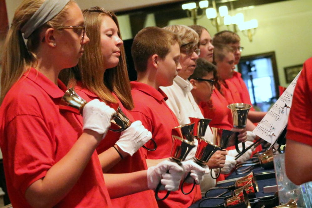 "The First United Methodist Church was alive with the sounds of bells this afternoon as four area English handbell choirs preformed preformed everything from Wagner to Katy Perry. Here, members of the Klipnocky Klangers preform ""Love So Wonderous"" by Karen Thompson. From left: Mikaela Buzzy, Alex Louckes, Quinn Hanson, Dylan Sorensen, Cappagnia-Lynne Chase, Ryan Miller and Devon Louckes. (Ian Austin/AllOTSEGO.com)"