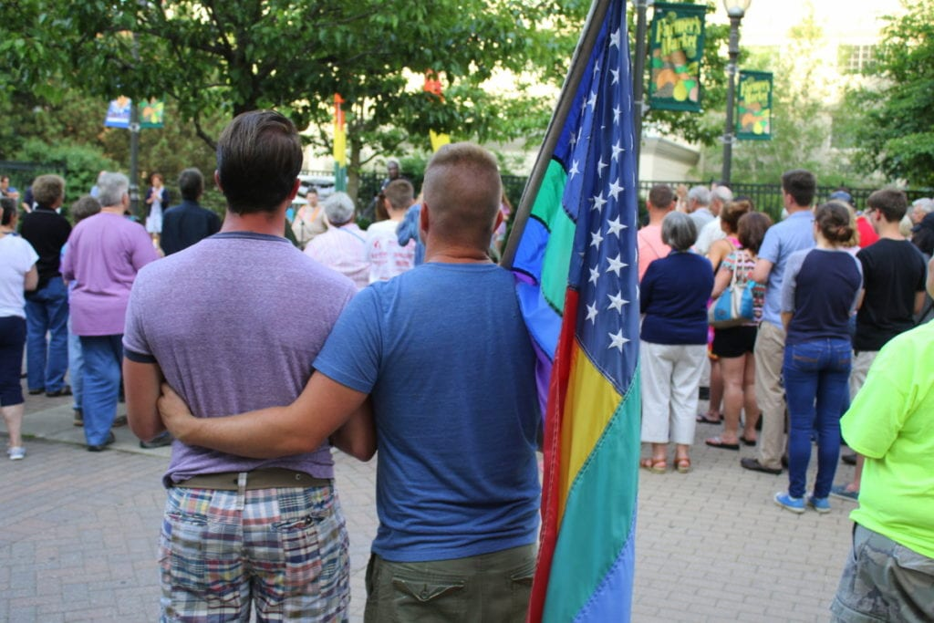 Jason Curley, left, Oneonta stands with his fiancé Chase Crupo among the crowd that gathered this evening in Muller Plaza for a candlelight vigil in response to the recent shooting at the Pulse nightclub Orlando, Fla. that left 49 dead and 53 injured. (Ian Austin/AllOTSEGO.com)