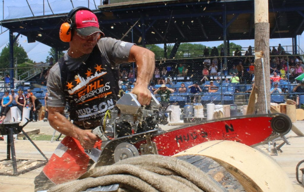 "Nathan Waterfield, Cherry Valley, organizer of the lumberjack competition held in Damaschke Field this weekend in the Hot Shots event where competitor try for best time in cutting through a 23"" thick log in seconds. The saw he is using is customized and features a snow mobile engine. Then event, no win it's second year, featured 24 men and 10 women. ""It's as rather obscure sport."" said Waterfield, ""So, the fact we are having this means we have people coming in from all over.""(Ian Austin/AllOTSEGO.com)"