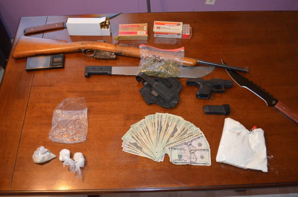 Cash, drugs and weapons were seized yesterday in a the Worcester mobile home of Paul James Velleca, a convicted felon.