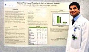 Dr. Kotakonda and his research poster board.
