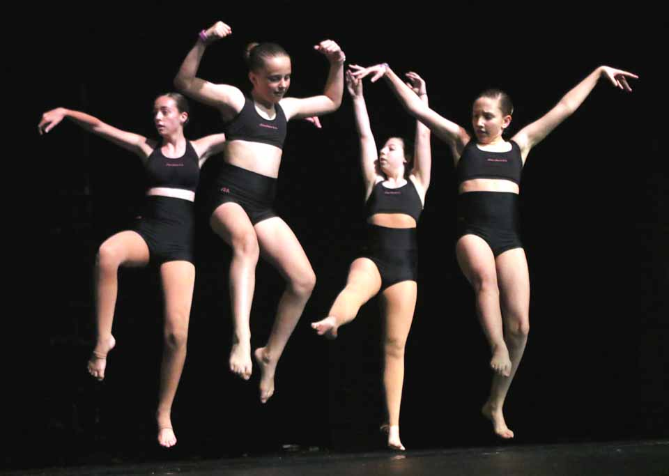 """Jillian's Dance Arts students, from left, Megan Catella, Sabonne Schuman, Allie Miller and Alexandra Deleski, all of Oneonta, rehearse earlier this week for """"Love Makes The World Go Around,"""" with performances continuing this evening at 7 and Sunday afternoon at 2 at SUNY Oneonta's Goodrich Theatre. Tickets $12. (Ian Austin/AllOTSEGO.com)"""