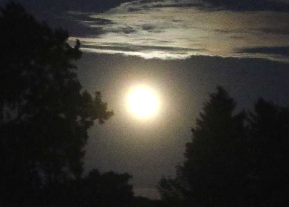 A rare strawberry moon is visible from the Clark Sports Center fields and across Otsego County at this hour. Strawberry, because it coincides with the height of the strawberry season. What's rare about tonight's full moon is that it coincides with the Summer Solstice, the longest day of the year. That hasn't happened since 1967 and won't happen again until 2062. (Jim Kevlin/llOTSEGO.com)