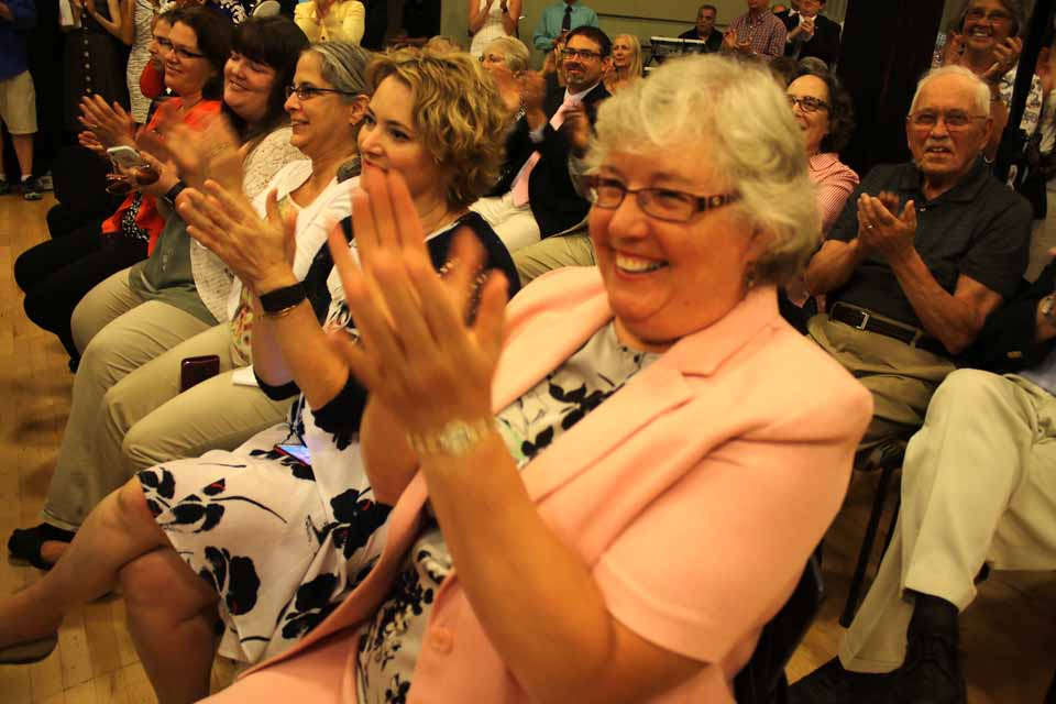 Oneonta's First Lady Connie Herzig joins in the wild applause when the $10 mllion special allocation for downtown redevelopment in the City of the Hills was announced announced at Foothills. (Jim Kevlin/AllOTSEGO.com)
