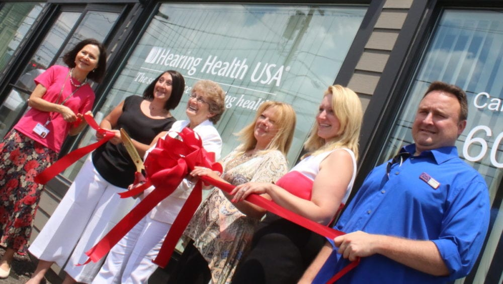 Debra Marcus, Mindy Staller, Linda Horovitz, Dorothy McKee, Barbara Ann Heegan and Anthony Wahl pose during a ceremonial ribbon cutting as the Otsego County Chamber welcomed Hearing Health USA to Oneonta this afternoon. They will provide diagnostic hearing evaluations and treatment in way of hearing aids for all ages. They have also been approved to serve veterans free of charge if they have been certified for hearing aids. Hearing Health USA will be holding complimentary hearing tests on July 18th and 19th from 8-4pm at 392 Chestnut St. in Oneonta. (Ian Austin/AllOTSEGO.com)