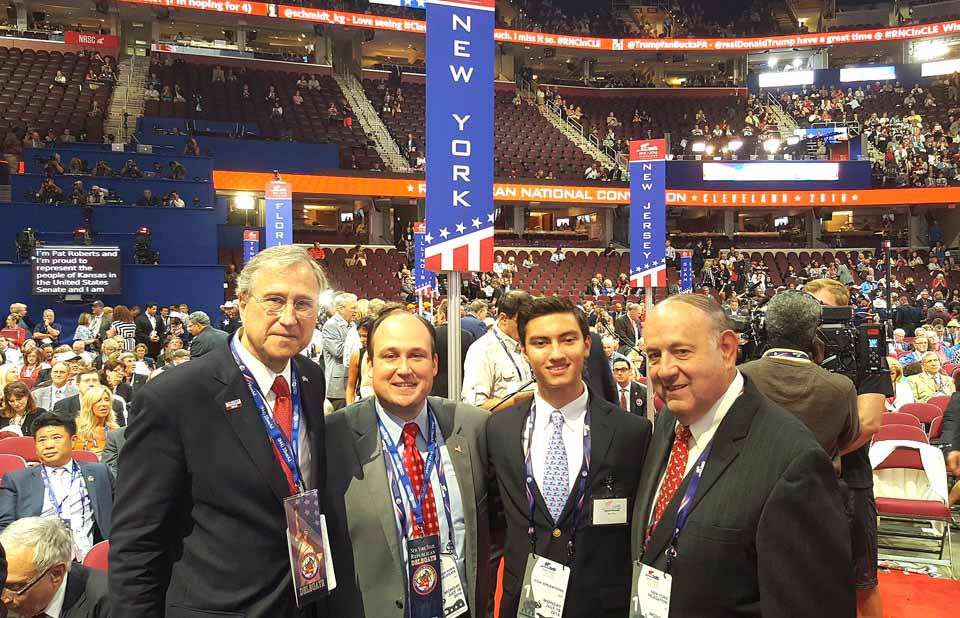 Jacob Russell, Cooperstown, a page at the Republican National Convention in Cleveland, which opened today joins, from left, State Chairman Ed Cox, Erie County Chairman Nick Langworthy and Tony Casale, Cooperstown, the retired Assemblyman on the convention floor in the Quicken Loans Center. Russell, a CCS grad, has just completed his freshman year at Harvard.