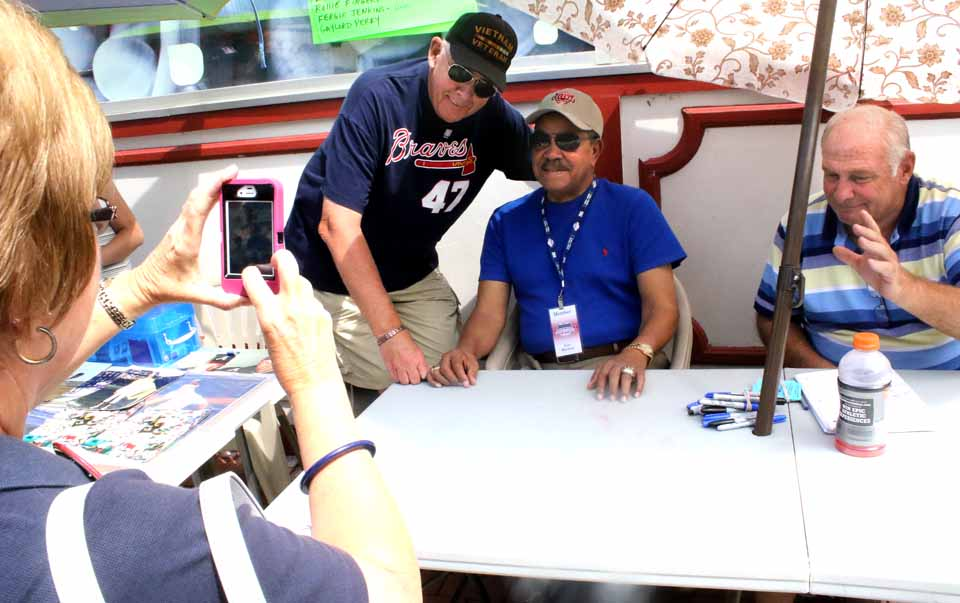 Juan Marichal pauses from signing autographs during Induction Weekend 2015. He's be back at CVS this weekend, again signing autographs. (AllOTSEGO.com)