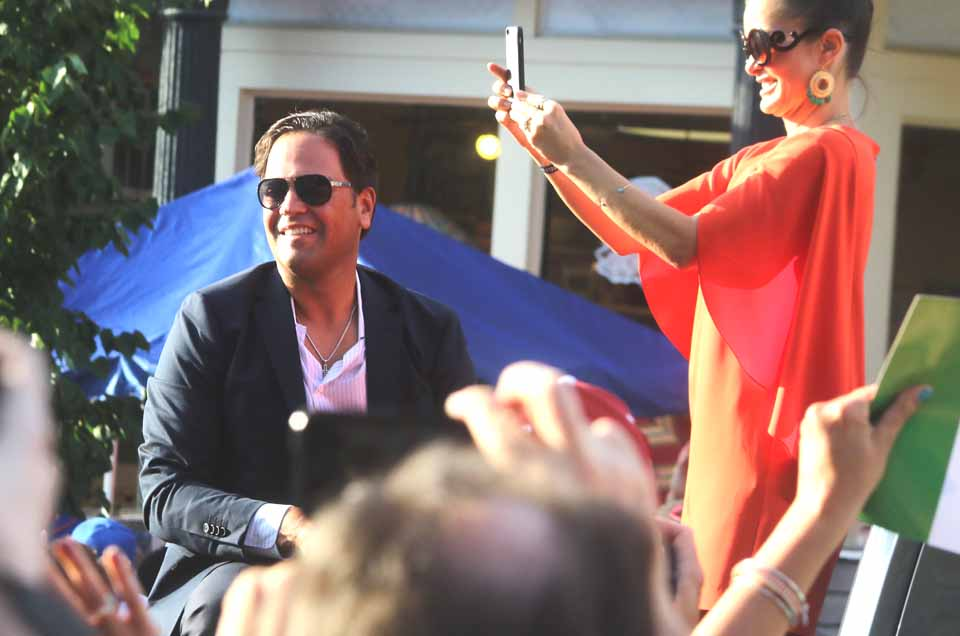 Inductee Mike Piazza, who will entered Baseball's Shrine tomorrow, and wife and former Playboy Bunny Alicia Rickter smile at the acclaim received from Mets fans and the baseball public generally as they rode in the annual Legends of Baseball Parade that ended a few minutes ago in downtown Cooperstown (AllOTSEGO.com)