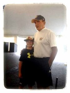 "Lou Presutti – ""coach,"" and he was known to the tens of thousands of youngsters who competed at Dreams Park over the years, poses with an attendee."