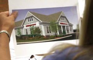 """An artist's rendering of """"The Cooperstown Concept,"""" designed by CVS' architects to be more in keeping with the village's ambience, was passed around at this evening's public hearing."""