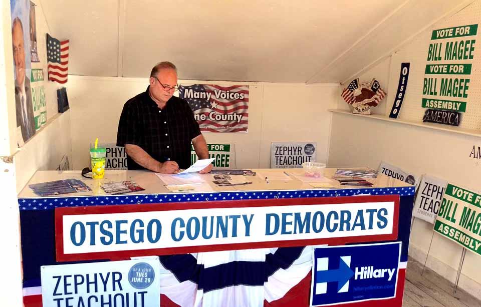 For the 40th year, the Otsego County Democratic Committee is manning a booth under the grandstand at the Otsego County fair, underway in Morris through Sunday.   Here, county Chair Richard Abbate, Cooperstown, holds down the fort.  Oneonta's Leon Kalmus and Jim Dean and Hank Nicols, both of Cooperstown, have manned the booth so far.  (Jim Dean photo)