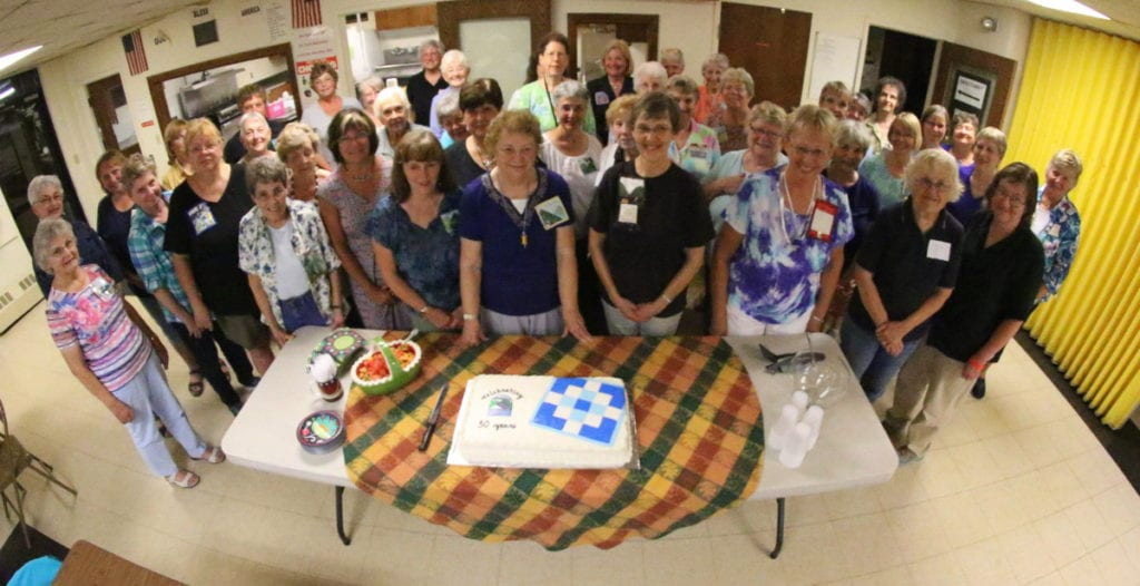 The ladies of the Susquehanna Valley Quilters gather for a photo before cutting the cake to celebrate the group's 30th birthday this evening at Elm Park Methodist Church. (Ian Austin/AllOTSEGO.com)