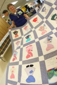 Barbara Blanchard shows off the Sunbonnet Sue quilt her class made for her. (Ian Austin/AllOTSEGO.com)